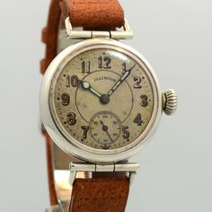 A 1918 vintage Sterling Silver Illinois timepiece with a patinated, silver dial with gold luminous Arabic numerals, a 17-jewel manual-wind movement and a light brown, Pig Skin watch strap. (Store Inventory # 10089, listed at $1200).   #illinois #silver #dial #silver #cool #watch #watches #mens #classic #vintage #timepieces #stawc
