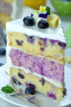 Lemon Blueberry Cheesecake Cake the perfect blueberry dessert for summer! Made w… Lemon Blueberry Cheesecake Cake the perfect blueberry dessert for summer! Made with lemon cake, blueberry cheesecake and lemon cream cheese frosting. Lemon Blueberry Cheesecake, Blueberry Desserts, Blueberry Cake, Lemon Cheesecake, Cheesecake Recipes, Layer Cheesecake, Classic Cheesecake, Cheesecake Bites, Desserts Rafraîchissants