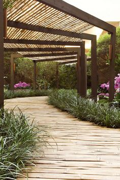 "A garden deck built from giant, 6"" wide bamboo strips."