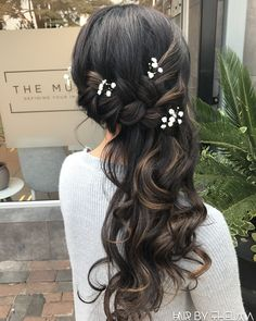 Bridesmaid Hairstyles, side braided hairstyles decorated with babies breath flowers. Event hair, brides hair, braided hairstyles. Follow @hairbythelma on Insta #hairbythelma