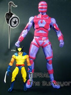 this is a marvel legends Tefral the Surveyor Custom Action Figure he was made by figure realmer argenta-2008 he used a 12 inch movie spiderman body and lots of foamy happy pinning