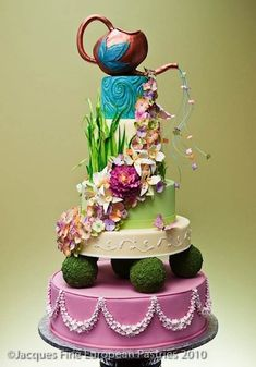 Not sure which board to pin this one to... Love the 'Alice in Wonderland' feel to this cake!
