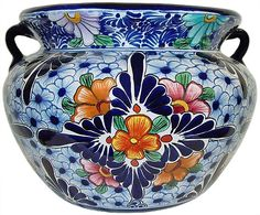 I love the bright designs of Talivera pottery.  They transfer well to tire planters and will last through freezing temperatures. Learn more at http://shop.tirecrafting.com/