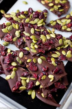Cranberry pumpkin seed dark chocolate bark tastes just like fall and is super simple to whip up with only 4 ingredients! (gluten free, grain free, paleo, and vegan) (Dark Chocolate Recipes) Köstliche Desserts, Holiday Desserts, Delicious Desserts, Dessert Recipes, Healthy Desserts, Healthy Christmas Recipes, Cranberry Dessert, Chocolate Bark, Chocolate Recipes