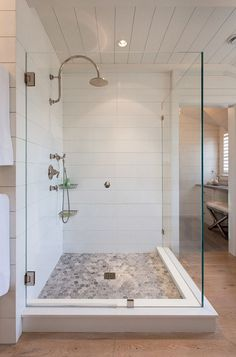 Shower detail:  The builder milled Corian to match the the wooden shiplap coming in from each side.