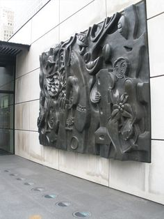 "The ""Femmes au Perroquet"" is a 1952 bronze relief art sculpture by Fernand Leger found in the brand new Citygarden in downtown St. Louis, Missouri."