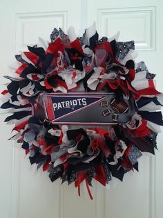 "New England PATRIOTS wreath / NFL / Home Décor/ Gift $ 82.00 The PATRIOTS are a top team going into the SUPER BOWL 2017! Show your pride for them with my beautiful handmade 24"" wreath in your own home or consider it as a gift for another true fan! I have  worked it with numerous team color hand cut fabrics and attached a black board in the center with a Patriots pennant."
