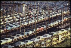 New Chrysler manufactured cars line up and are loaded onto railroad cars at Lasher and I-75 in the 1970s