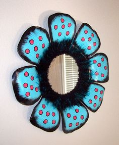 love the idea of a record mirror. this one has been altered, painted, and embellished, it looks like