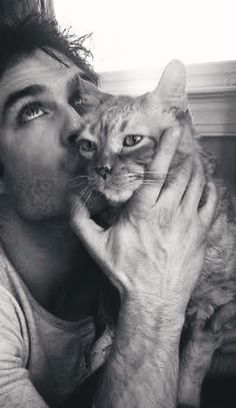 Ian Somerhalder  Ok, I don't even like cats but this guy is perfect. He's gorgeous AND he loves animals!!?
