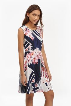 "<ul> <li> Fit and flare printed mini dress with geometric and floral cutabout print</li> <li> Round neck</li> <li> Contrasting side panels</li> <li> Zip fastening at back</li> <li> <strong>Please note: </strong>Due to the pattern's individual nature, print placement will vary from one dress to the next. No two pieces will be exactly alike.</li> <li> UK size 10 length is 84.5cm</li> </ul>  <strong>Our model is 5ft 10"" and is wearing a UK size 8.</strong>"