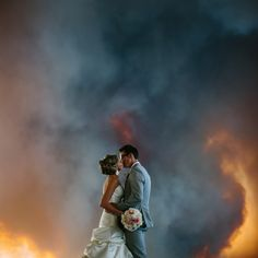 Super gorgeous wedding photos taken in front of the wildfire that drove the couple from their venue.