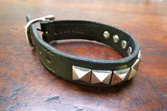 Awesome handmade sterling silver & leather pyramid stud bracelet. Vegetable dyed leather, hand sewn.  Pretty, pretty, pretty sweet.