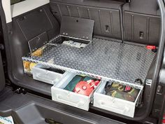 Off-Road-AmStar H3 Cargo Drawers Could build one out of wood and add removable carpet top