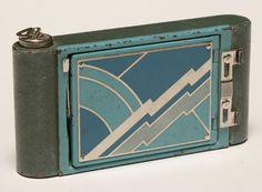 Kodak Art Deco folding blue bellows camera petite in Lightening Bolt enamel case ca. 1929.