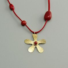 Tumbaga flower long necklace, necklace with gold toned hammered pendant and vegetable ivory nut, necklace with red tagua nut and coral stone by ColorLatinoJewelry on Etsy