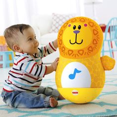 Lion's sturdy, weighted base makes him bounce back for more with every bat, encouraging baby to play