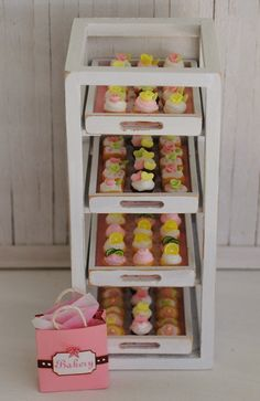 Miniature Bakery Display Rack Filled With An Assortment of Cupcakes, Cookies, And Cake Squares, A Pink Bakery Bag, And A Plate Of Sweets. $95.00, via Etsy.