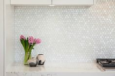 Classic kitchen with octagon mother of pearl mosaic backsplash