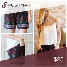 """Black and red floral shorts Modeling size small.  100% rayon. Waist laying flat: S 13"""" M 14"""" L 15"""", length S 14"""" M 15"""" L 16"""". Inseam 2"""".  Add to bundle to save when purchasing.  RR3500324 Shorts"""
