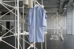 <p>Inspired by the Atom, this minimalist pop-up store in Milan was designed by Bonsoir Paris for COS to house their Spring/Summer 2013 ready-to-wear collection for the annual Salone del Mobile furnitu