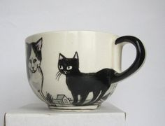 cute mug idea, use a sharpie to draw on a white mug then bake it....just one cat mug? That doesn't put me in cat-lady territory, right?