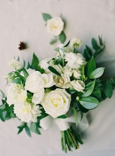 weedding bouquet greenery leaves white roses dahlia flowers wrapped with ribbon exposed stems White Dahlia Bouquet, Dahlia Wedding Bouquets, White Dahlias, White Roses, Dahlia Flowers, White Bouquets, Wedding Flowers, Greenery Centerpiece, Greenery Garland