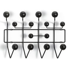 Discover the authentic Eames® Hang-It-All® from Herman Miller, a classic midcentury modern design by Charles and Ray Eames, available in five color combinations. Shop the Eames Hang It All and Eames coat rack. Hanger Rack, Coat Hanger, Coat Hooks, Wall Hanger, Clothes Hanger, Charles Eames, Charles Ray, Design Shop, Rack Design