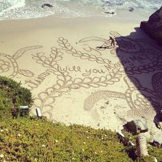 beach sand marriage proposal