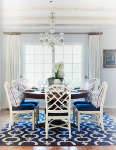 Brown Round Table and White Chic Chairs