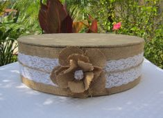 Elevate your cake with a Beautiful Natural Burlap and Lace Cake Stand! Wedding, Engagement, Quinceanera, Anniversary, Birthday, Bridal Shower, Sweet 16, Baby Shower etc...  These are 4 tall Foam Cake Stands with Burlap and Lace on the sides tied with a jute string and a Large Burlap Flower with matching Burlap Cake Board on top!  They are lightweight and very sturdy to support your cake! It can easily support a 5 tier or larger cake and has been tested to hold over 150 lbs. without any…