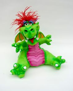Edison, a neon-colored dragon puppet, from Creatures of Delight.