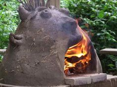 pizza oven built with children at a school in Norfolk- Edwards & Eve Cob Building