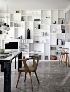 Various shaped shelves, like Mondrian painting interesting wall design