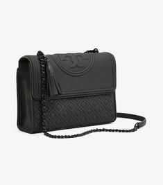 Visit Tory Burch to shop for Fleming Matte Convertible Shoulder Bag and more Womens View All. Find designer shoes, handbags, clothing & more of this season's latest styles from designer Tory Burch. Tory Burch Tasche, Tory Burch Bag, Backpack Purse, Crossbody Bag, Fashion Bags, Women's Fashion, Saddle Bags, Purses And Bags, Shoulder Bags