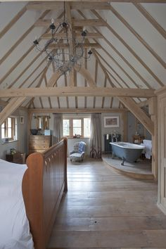 Master bedroom. We love the space and Moyna likes my King Post (the vertical oak post high up in the roof space).