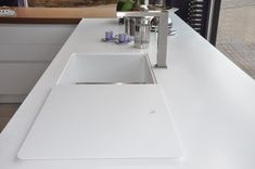 Solid Surface Material offers the possibility if a cover for the sink.