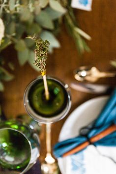 DIY herb stirrers for your wine: http://www.stylemepretty.com/living/2014/11/13/diy-herb-drink-stirrers-with-pier-1-imports/