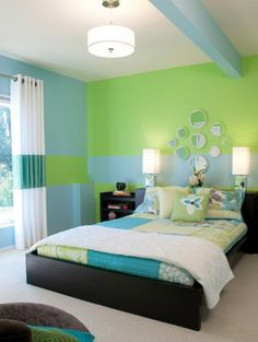 Painting the walls in this teen's bedroom in a color-blocked pattern helped the client's existing low-profile furniture work well with the room's high ceilings. Instead of trying to camouflage a ceiling support beam, the designer highlighted it with turquoise paint — turning a design flaw into an interesting architectural element. Design by Nancy Barrett of Decorating Den Interiors; photographery by Anne Matheis