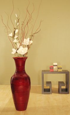 Accent your home decor with this bamboo floor vase and white magnolias. Complete with a red mahogany finish to bring this gorgeous floral decor together. Gorgeous floor vase has been handcrafted by ar