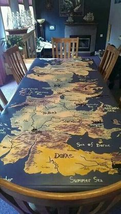 Game Of Thrones Hand Painted Westeros Table Take one Table, six house paint samples from Home Depot, and one Game of Thrones superfan with too much time on their hands. Game Of Thrones Decor, Game Of Thrones Map, Game Of Thrones Party, Game Of Thrones Stuff, Game Of Thrones Birthday, Game Of Thrones Houses, Casa Targaryen, Game Of Thones, Got Party