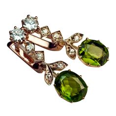 Russian Demantoid Diamond Silver Gold Earrings. Circa 1910 (ear pendants) with replaced closures (modern)  The earrings feature a pair of large demantoid garnets.   c1910