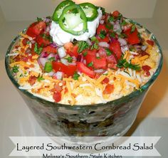 This Layered Southwestern Cornbread Salad is not only tasty but makes a spectacular edible centerpiece. Layers of flavor with a spicy ranch dressing.