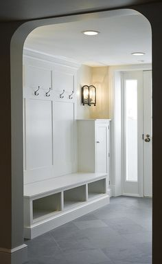 #mudroom #Interiors - slate, crisp white bench and panels with hooks. Perfect!