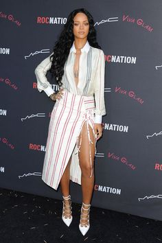 In Altuzarra at the Roc Nation Pre-Grammy Brunch 2014 in Los Angeles. See all of Rihanna's best looks.
