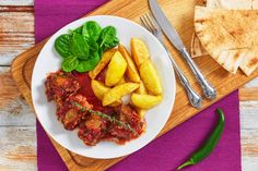 oxtail stew with fried potato and spinach salad