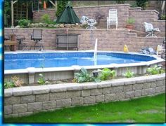 semi-inground pool with decorative brick retaining wall