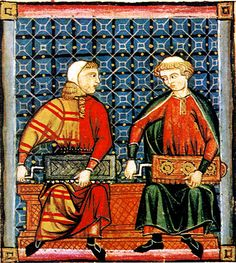 Musicians wear two long tunics, one over the other. The tunic on the left is an early example of mi-parti or particolored clothing, made from two fabrics. Cantigas de Santa Maria, mid-13th century, Spain. Website: www.pbm.com/~lindahl/cantigas/ Wiki: http://en.wikipedia.org/wiki/File:Symphonia_Cantigas_Sta_Mar%C3%ADa_160.jpg