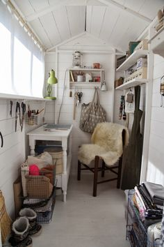 Above: The shed's interior is painted a bright white, and filled with tools and equipment for Artemis's sewing and craft projects