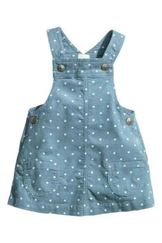 Bib dress in cotton corduroy with a printed pattern. Suspenders with snap fasteners, patch pockets at front, and snap fasteners at sides. Baby Girl Dress Patterns, Little Girl Dresses, Girls Dresses, Toddler Outfits, Kids Outfits, Baby Overalls, Overalls Style, Overalls Fashion, Kids Frocks